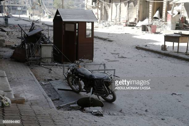 Destruction is seen following Syrian government shelling on the rebelheld besieged town of Ayn Tarma in the eastern Ghouta region on the outskirts of...