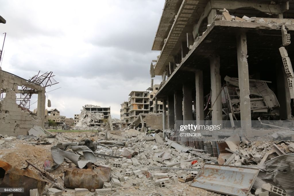 Destruction is seen in the former rebel-held town of Saqba in the Eastern Ghouta region on the outskirts of the Syrian capital Damascus on April 10, 2018. PHOTO / STRINGER