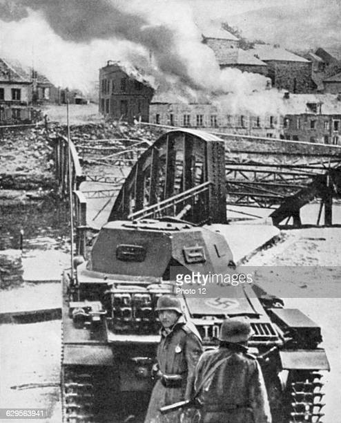Destruction of bridge over River Meuse by the Belgians in an attempt to stop the German advance Here German light tank temporarily checked 1314 May...