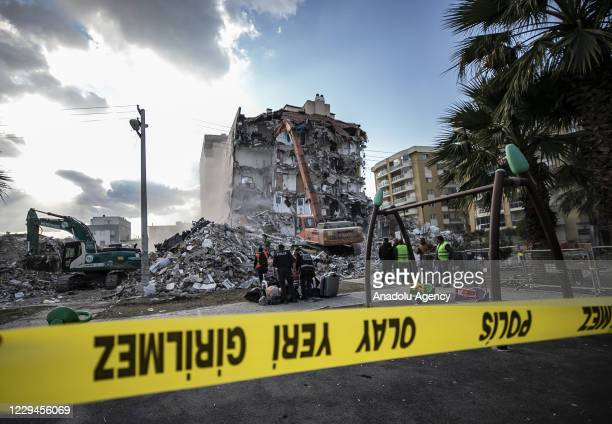 Destruction works continue for damaged building in Baris Site located in Bayrakli district days after a magnitude 6.6 quake shook Turkey's Aegean Sea...