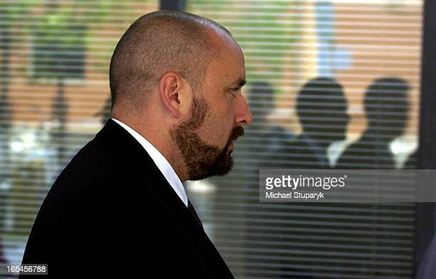 Det Const Dan Belanger returning to Coroner's Court after lunch break with goatee and shaved head Jeffrey Reodica police shooting case Lawyers...