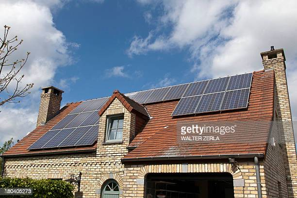 Detached house with solar panels on roof