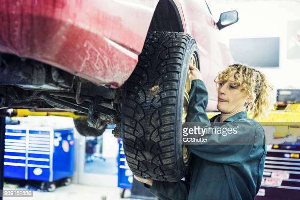 detaching a tire to have it changed - dismantling stock pictures, royalty-free photos & images