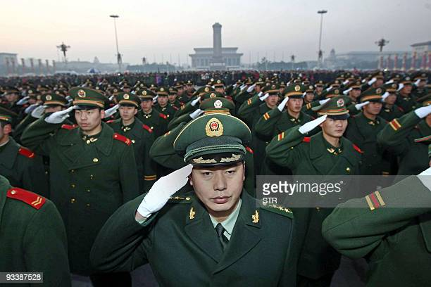 A detachment of the Chinese People's Armed Police responsible for the security of Tiananmen Square and the Forbidden City gather for a ceremony to...