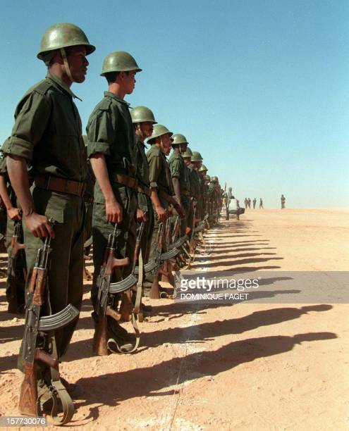 A detachment of the Polisario front soldiers parade in Samra's refugees camp near Tindouf Algeria A ceasefire in the conflict opposing the Polisario...