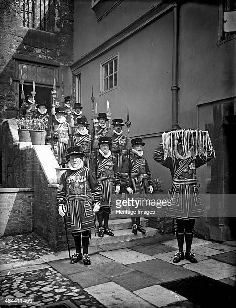 A detachment of Yeomen of the Guard in ceremonial dress escort the Maundy Money across the Abbots Courtyard Dean's Yard Westminster Abbey London