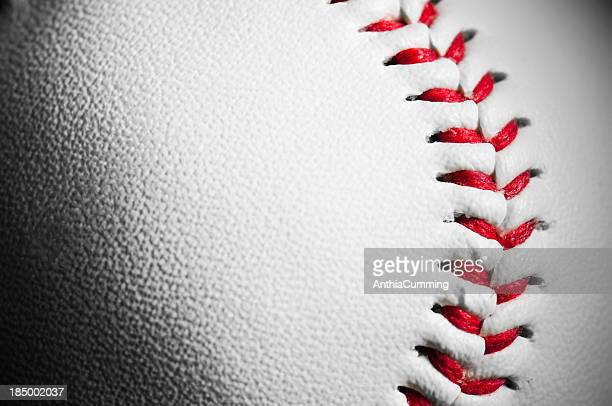 detail and texture of white leather baseball with red stitching - honkbal teamsport stockfoto's en -beelden