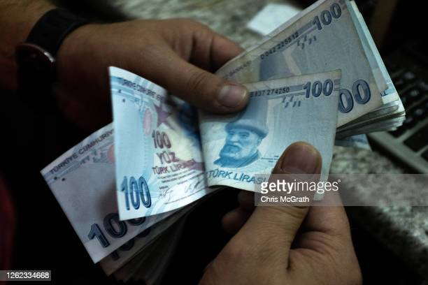 Detail as a man counts Turkish Lira at a currency exchange office on July 29, 2020 in Istanbul, Turkey. The Turkish Lira remains under pressure after...