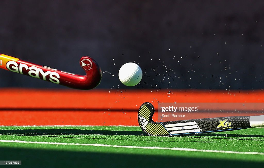 A detail as two players compete for the ball with their hockey sticks during the match between Australia and the Netherlands during day two of the Champions Trophy on December 2, 2012 in Melbourne, Australia.