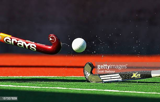 A detail as two players compete for the ball with their hockey sticks during the match between Australia and the Netherlands during day two of the...
