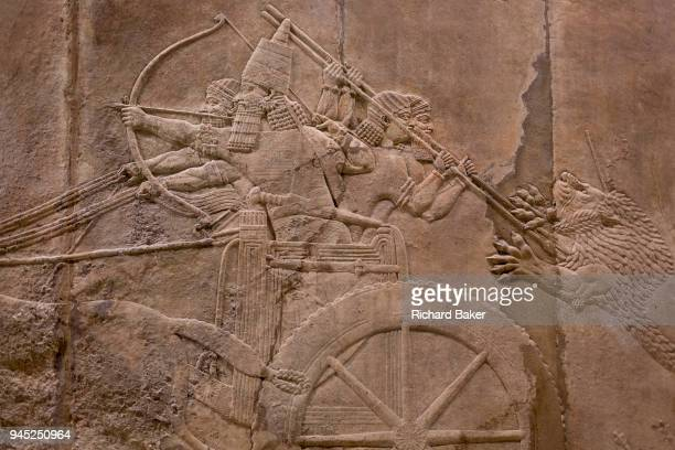 A detail from a stone carving depicting the royal lion hunt of the Assyrian king Ashurbanipal at the British Museum on 11th April 2018 in London...