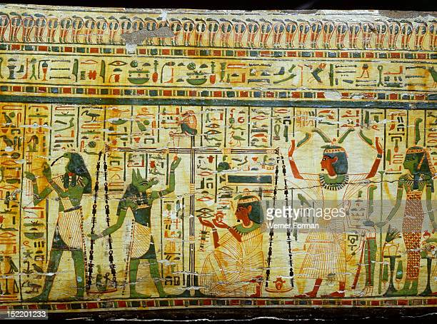 Detail from coffin of Nespawershepi chief scribe of the Temple of AmunThe weighing of the heart in the Hall of Judgement The owner watches as his...