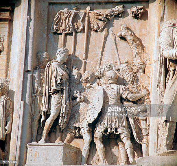 Detail from the arch of Constantine showing a Caesar possibly Hadrian addressing his troops 3rd century