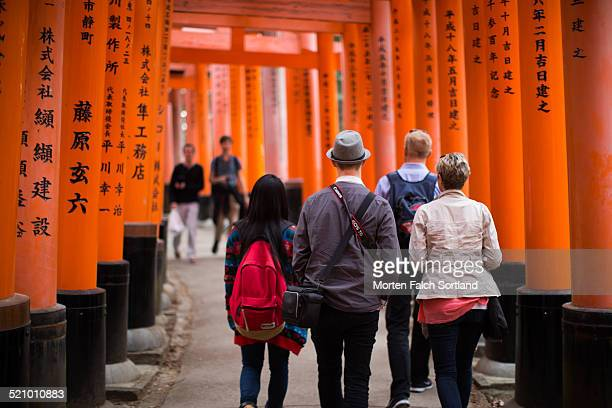 Detail from the Fushimi Inari Shrine just outside Kyoto where in the walk of Toriis the Toriis are so close to each other that one feels like one is...