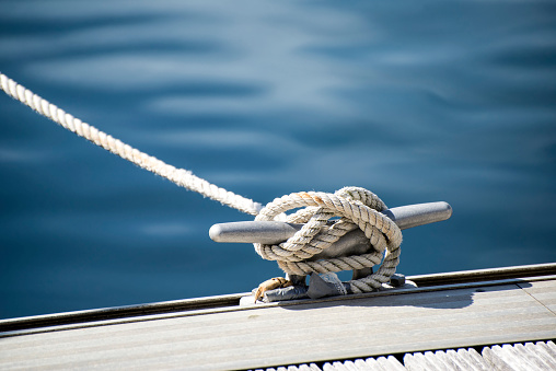 Detail image of yacht rope cleat on sailboat deck 471815975