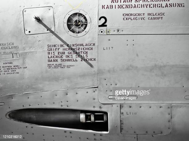 detail in monochrome of fuselage and gun on military jet fighter - war stock pictures, royalty-free photos & images