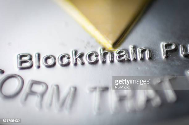 A detail is seen on a replica Ether cryptocurrency coin based on the Ethereum technology in this photo illustration on November 8 2017