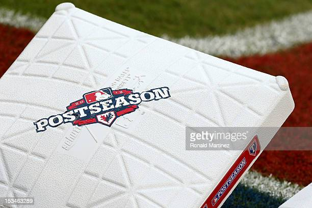 A detail of a base with the official Major League Postseason logo see on it prior to the Texas Rangers playing against the Baltimore Orioles during...