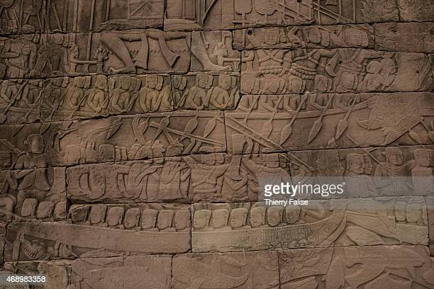 Detail of a bas-relief of Banteay Chhmar temple depicts warriors rowing in boats. The temple, built in the 12th century by king Jayavarman VII and...