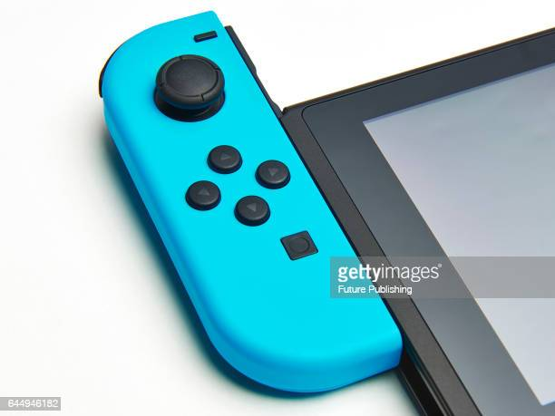 Detail of a blue JoyCon controller attached to a Nintendo Switch console taken on February 22 2017