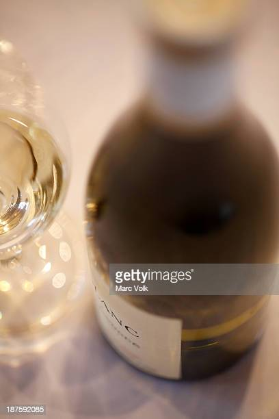 Detail of a bottle of white wine and a wine glass