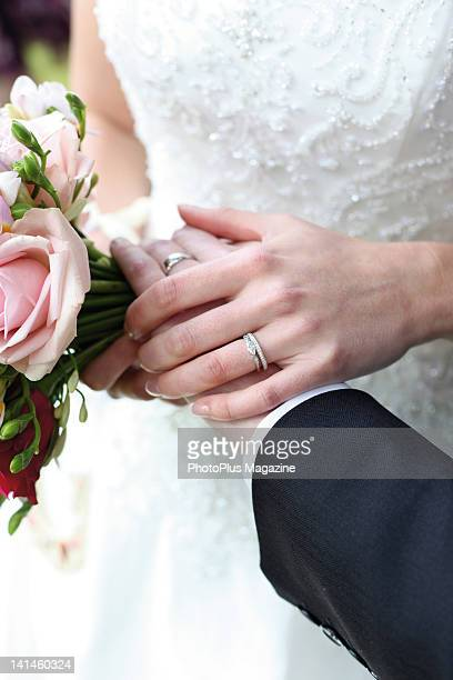 Detail of a bride and groom holding hands during a wedding, taken on May 8, 2009.