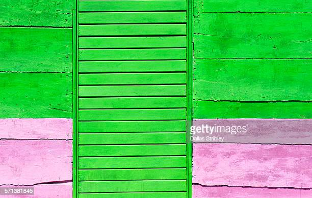 Detail of a bright pink and green wall, and door