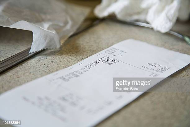 Detail of a cafe receipt on a counter