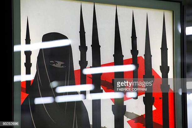 Detail of a campaign posters of the farright Swiss People's Party depicting a woman wearing a burqa against a background of a Swiss flag upon which...