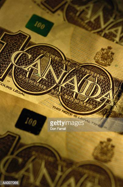 detail of a canadian one hundred dollar bill - canadian one hundred dollar bill stock pictures, royalty-free photos & images