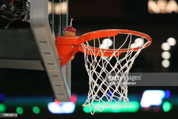 A detail of a candle lit on a cupcake sits on the rim for the birthday cake dunk completed by Gerald Green of the Minnesota Timberwolves during the...