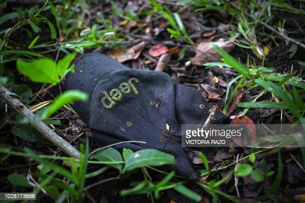 Detail of a cap found in a mass grave where authorities discovered at least 166 bodies since exhumations began on August 8 at Alvarado municipality...