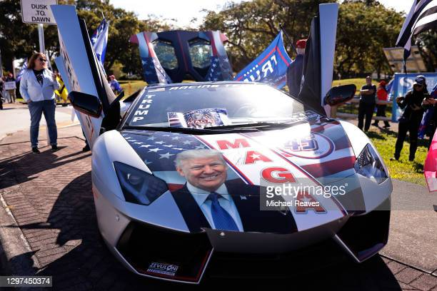 Detail of a car decorated in outgoing US President Donald Trump as his supporters await his return to Florida along the route leading to his...
