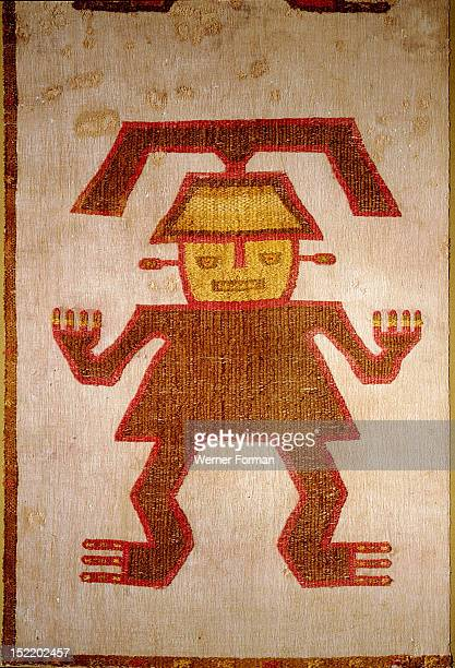 Detail of a ceremonial poncho with a figure embroidered in coloured llama wool onto a cotton base, It represents an elite person, possibly the owner,...