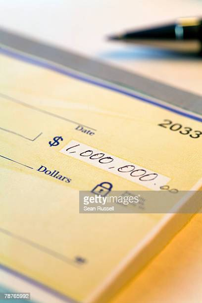 detail of a check for one million dollars - millionnaire stock pictures, royalty-free photos & images