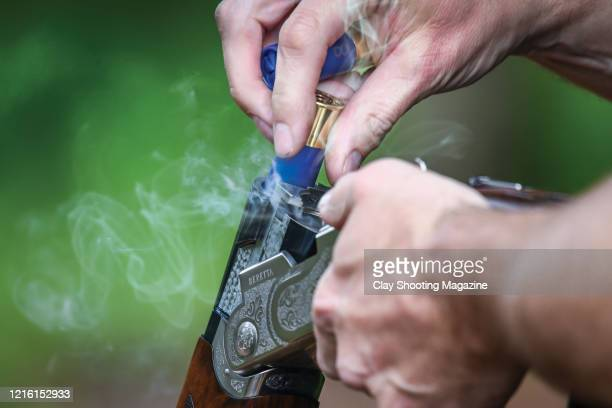 Detail of a clay pigeon shooter reloading a Beretta shotgun during the Clay Shooting Classic competition at Garlands Shooting Grounds in Tamworth,...