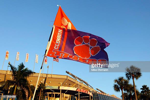 A detail of a Clemson Tigers flag attached to a car in the parking lot while fans tailgate outside the stadium prior to CLemson playing against the...