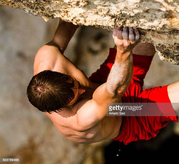 Detail of a climber grabbing a hold as he is climbing a psicobloc route in Kalymnos, Greece.