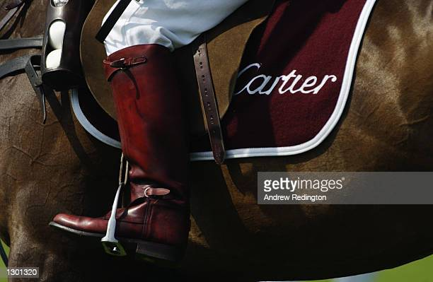Detail of a competitor's boot whilst riding a polo pony during the Cartier International Polo Day played at the Smiths Lawn Polo Grounds in Windsor...