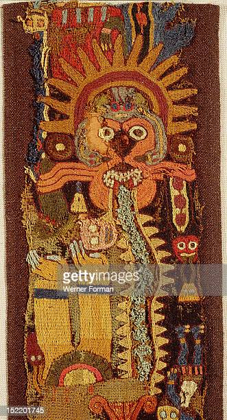 Detail of a complex Paracas linear style textile Shows the Oculate Being a mythical figure with an ornate headdress a protruding snake like tongue...