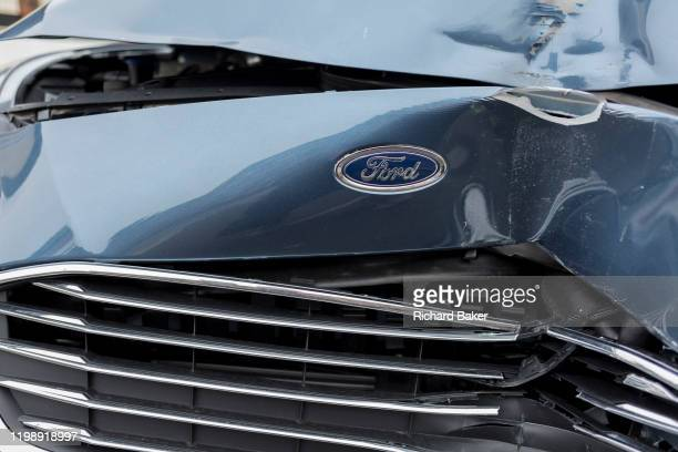 A detail of a crashed Ford car whose grill and bonnet has been crushed after a headon collision on 3rd February 2020 in London England According to...