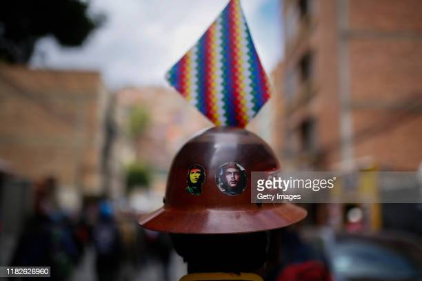 Detail of a demonstrator wearing a miner helmet with images of Che Guevara during a protest on November 15 2019 in La Paz Bolivia Morales flew to...