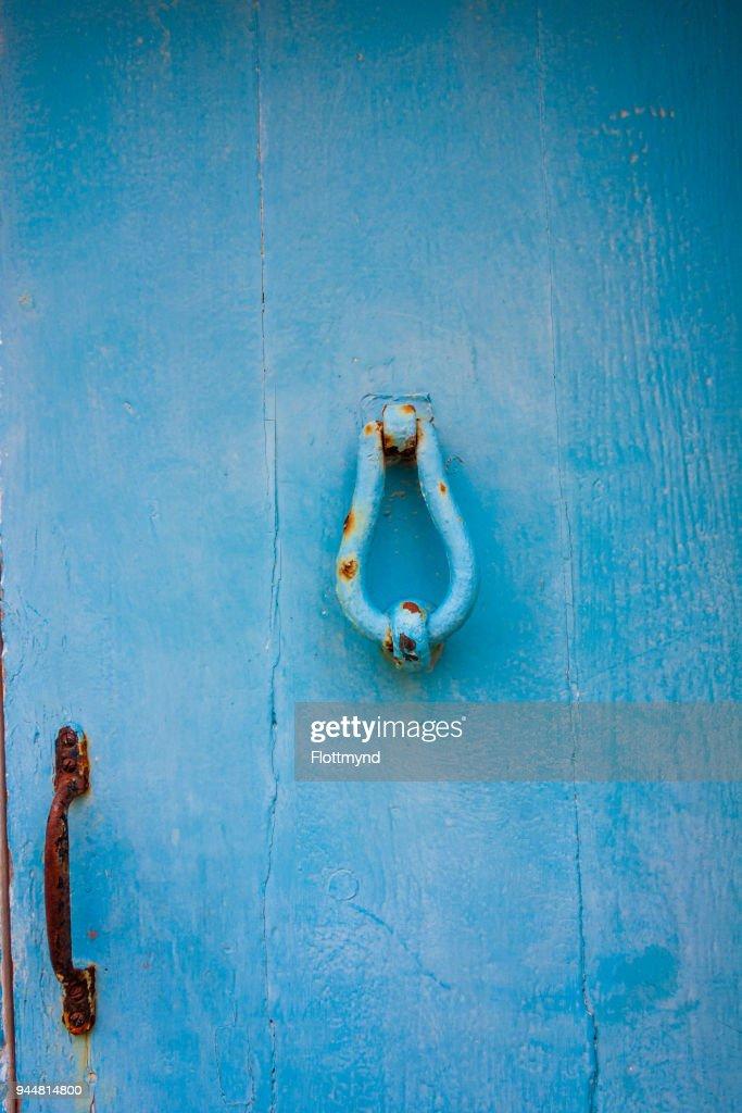Detail of a door knocker on a blue door in Gozo, Malta : Stock Photo