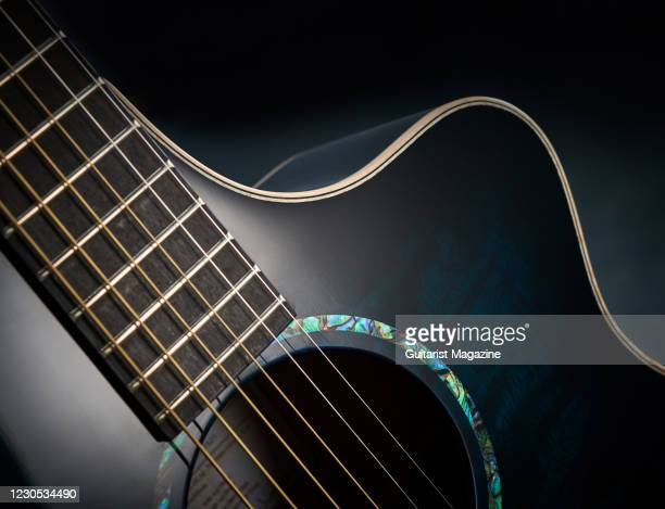 Detail of a Faith Neptune Blue Moon electro-acoustic guitar with a Blue Burst finish, taken on January 2, 2020.