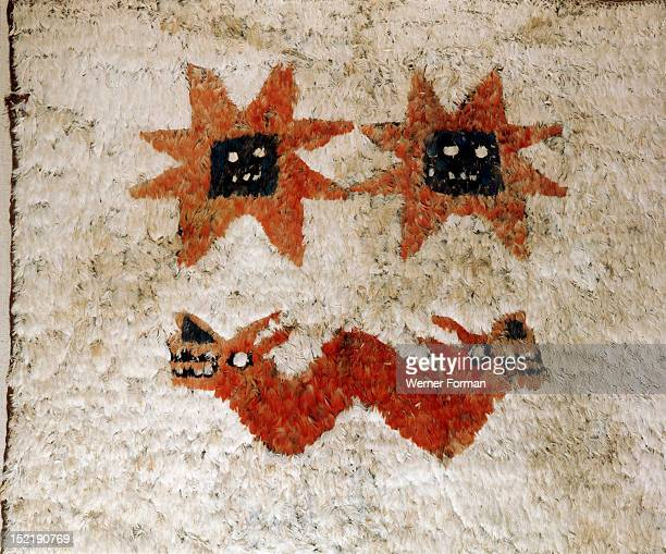 Detail of a featherwork panel from a larger mantle The central image is a typically Huari style double headed serpent with snarling feline mouths...