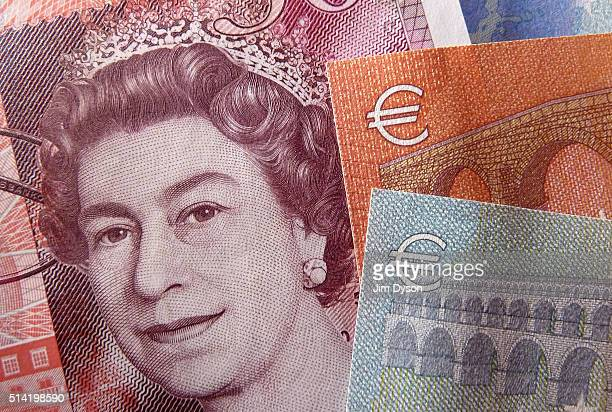 A detail of a fifty Pound bank note showing a portrait of Queen Elizabeth II and a five and ten Euro note on March 7 2016 in London England