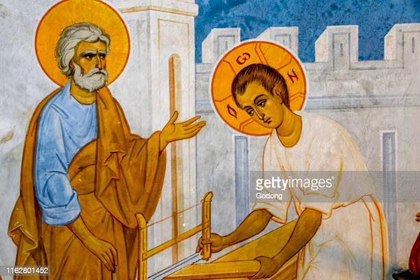 Detail of a fresco in the Greek orthodox church of the Annunciation, Nazareth, Israel. Jesus in St Joseph's carpentry workshop.