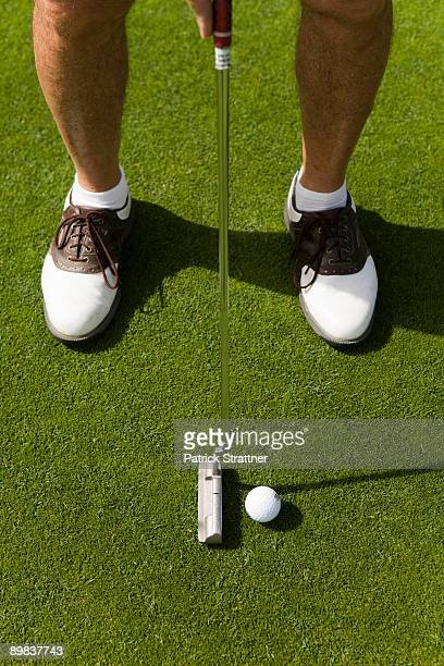 Detail of a golfer putting
