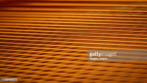 detail of a grand piano showing the geometric pattern of the strings - performing arts center stock pictures, royalty-free photos & images