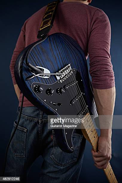 Detail of a guitarist holding a 2015 Fender Limited Edition Sandblasted Stratocaster With Ash Body electric guitar taken on January 13 2015